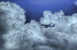 Airplane In Clouds