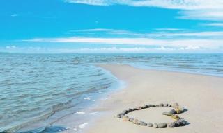 Heart Of Pebbles On Beach