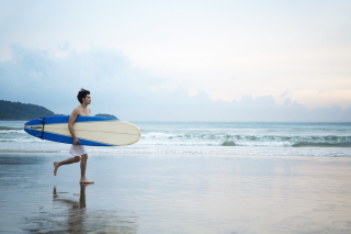 Guy Running With Surf Board