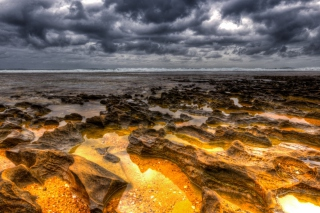 Hdr Dark Clouds And Gold Sand