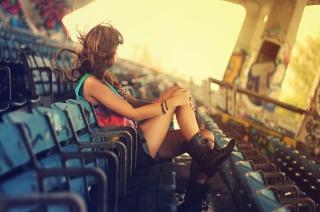 Girl Sitting In Stadium