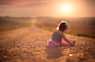 Child On Road At Sunset