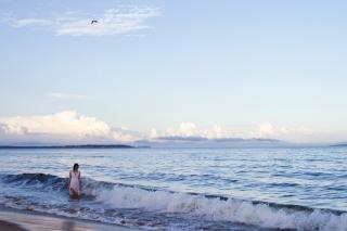 Big Ocean Waves Surrounding Little Girl