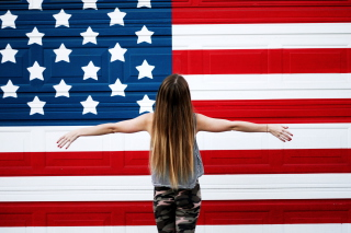 American Girl In Front Of USA Flag