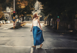 Girl In Long Blue Skirt On Street