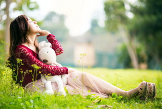Cute Asian Girl With Plush Rabbit